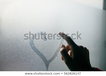 girl behind wet window Stock photo © fotoduki
