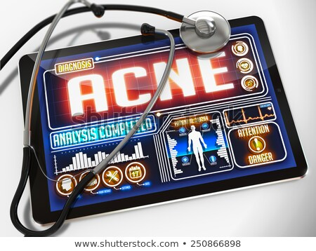Stock photo: Acne on the Display of Medical Tablet.