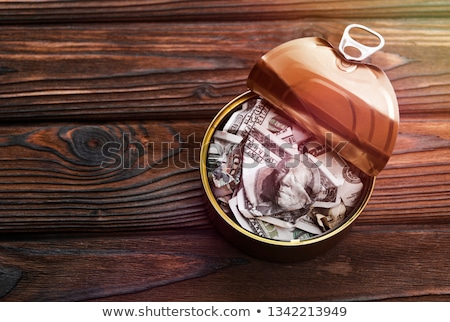 hundred dollar bill in open empty sardine fish tin can stock photo © stevanovicigor