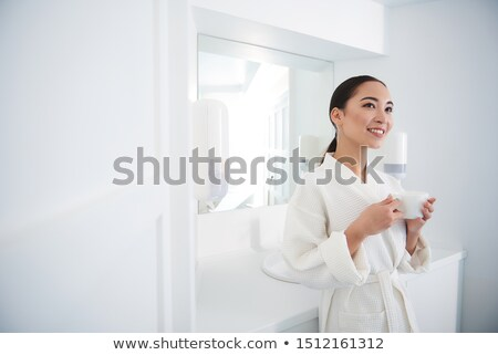Graceful attractive woman drinking a cup of tea Stock photo © dash
