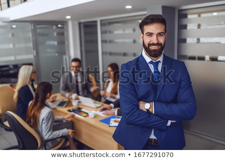Handsome focused businessman with arms crossed Stock photo © wavebreak_media