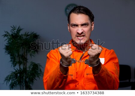 Angry prison inmate in dark room Stock photo © Elnur