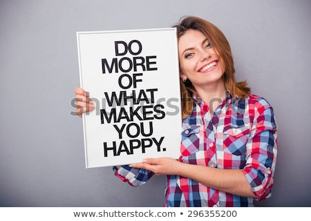 Woman holding board with motivational phrase Stock photo © deandrobot