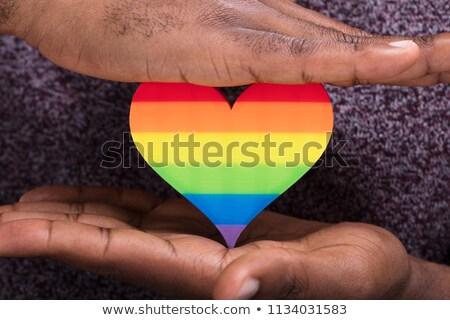palms of human hands thumbs up over rainbow Stock photo © dolgachov