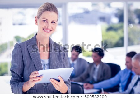 Business people taking notes and using tablet at a meeting Stock photo © wavebreak_media