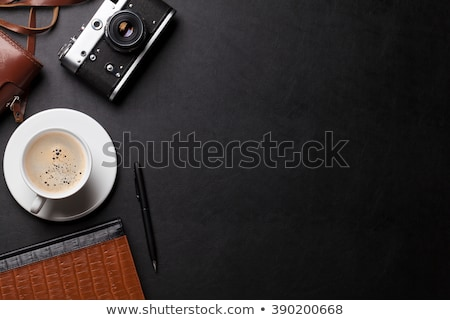 Stok fotoğraf: Desk With Camera Supplies And Coffee Cup