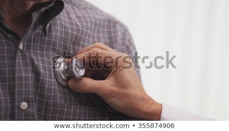 Closeup of hand checking heartbeat stock photo © nyul