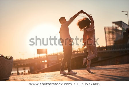 couple dancing at sunset Stock photo © adrenalina