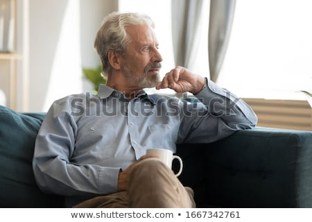 tired elderly retired man sitting thinking stock photo © ozgur