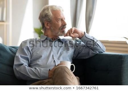 Zmęczony starszych emeryturę człowiek posiedzenia myślenia Zdjęcia stock © ozgur