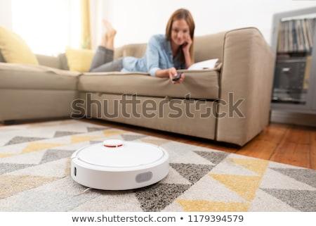 Woman with robot vacuum cleaner. Stock photo © RAStudio