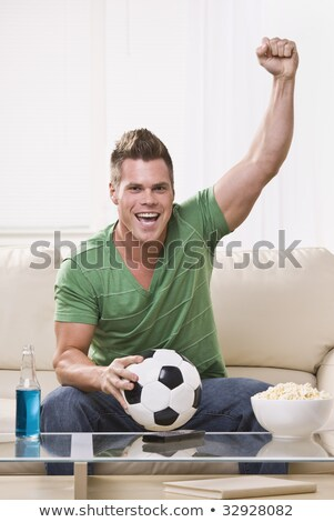 Excited Sports Fan Pumping Fists in Celebration Stock photo © ozgur