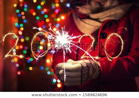 happy young women with sparklers over lights Stock photo © dolgachov