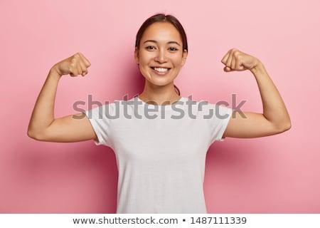 nő · sportruha · pózol · mutat · izmok · sport - stock fotó © dolgachov