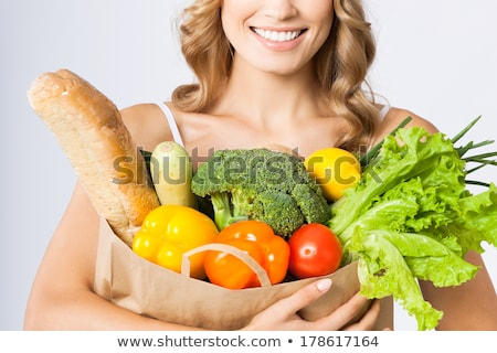 Healthy diet with a beautiful young blond. stock photo © lithian