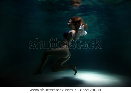 Stock photo: mysterious beautiful girl posing in the moonlight
