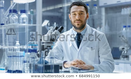 Young medical scientists working in modern lab, research with tubes stock photo © zurijeta