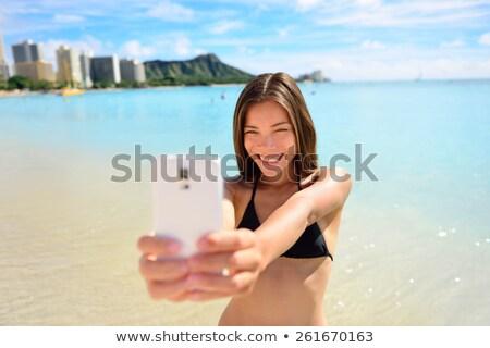 Stockfoto: Happy Beach Vacation Asian Girl Taking Swim Selfie