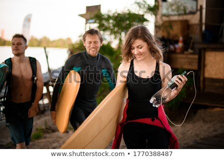 Donna sorridente tavola da surf Foto d'archivio © dash