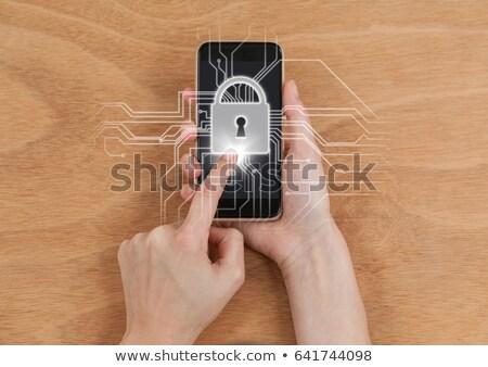 Ręce telefonu biały blokady graficzne migotać Zdjęcia stock © wavebreak_media