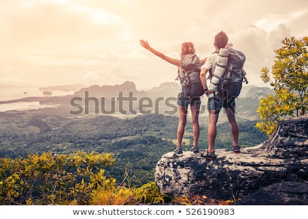 traveller with backpack standing on the rocks  Stock photo © chesterf