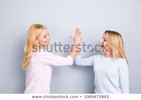 Smiling grandmother and granddaughter giving a high five Stock photo © wavebreak_media