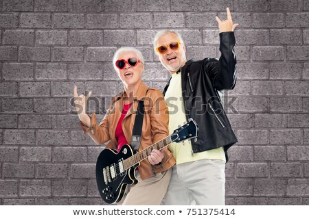 cool rock and roll couple with electric guitar  Stock photo © feedough