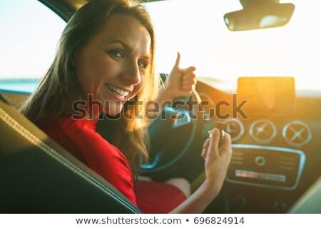 boldog · nő · vörös · ruha · kulcs · kéz · ül - stock fotó © vlad_star
