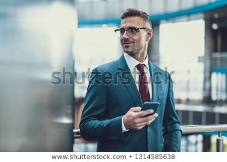 бизнесмен глядя портрет молодые элегантный человека Сток-фото © filipw