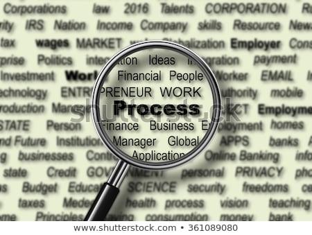 Foto stock: Business Goals Analysis Concept Through Magnifier