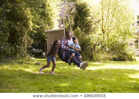 Boy and girl on tire swing Stock photo © IS2