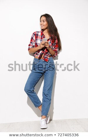 Full lenght photo of young happy woman with long brunette hair,  Stock photo © deandrobot