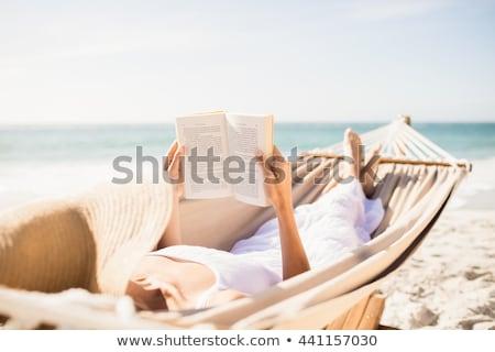 tengerpart · szórakoztatás · nyugodt · fiatal · szerelmespár · megnyugtató - stock fotó © is2