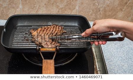 Nő főzés steak barbecue grill fiatal nő üveg Stock fotó © RAStudio