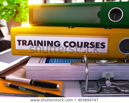 Yellow Office Folder with Inscription Training Courses. Stock photo © tashatuvango