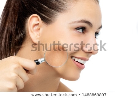 Woman in beauty concept with magnifying glass aging wrinkles Stock photo © Elnur