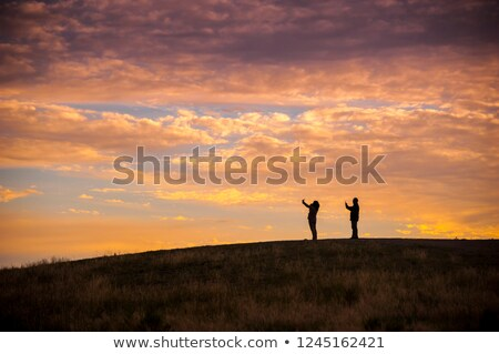 Two girls sketching on hillside Stock photo © IS2