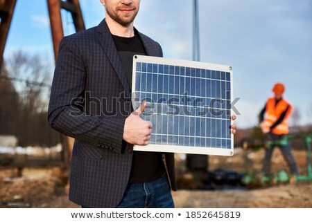 cropped image of a smiling businessman in a jacket working stock photo © deandrobot