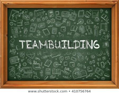 Teambuilding Concept. Green Chalkboard with Doodle Icons. Stock photo © tashatuvango