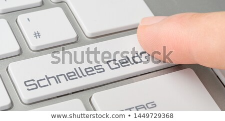 A keyboard with a labeled button - Easy Money Stock photo © Zerbor