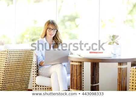middle-age woman in chair with shopping Stock photo © IS2