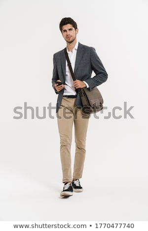 Full-length image of brunette businessman in jacket confidently  Stock photo © deandrobot