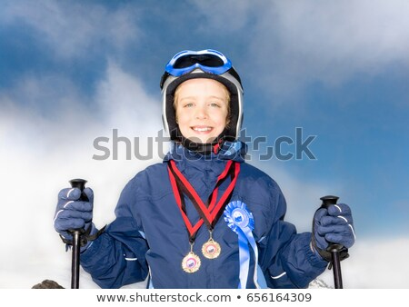 Boy wearing medals and with skis Stock photo © IS2
