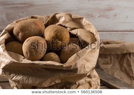 raw potatoes in brown paper bag stock photo © is2