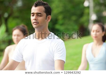 férfi · meditál · póz · meditáció · fehér · ázsiai - stock fotó © palangsi
