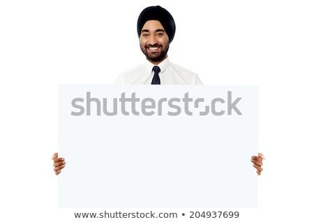 Indiai üzletember tart tábla szakállas üzlet Stock fotó © studioworkstock
