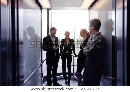Businesspeople standing in elevator Stock photo © wavebreak_media