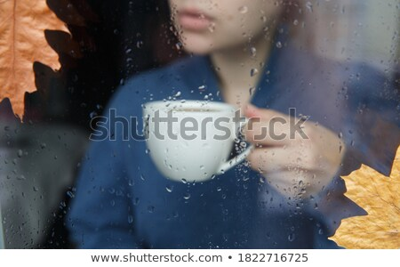 Stock photo: People looking out the window