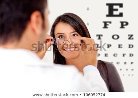 Joven examen de la vista gafas ilustración ojo Foto stock © bluering