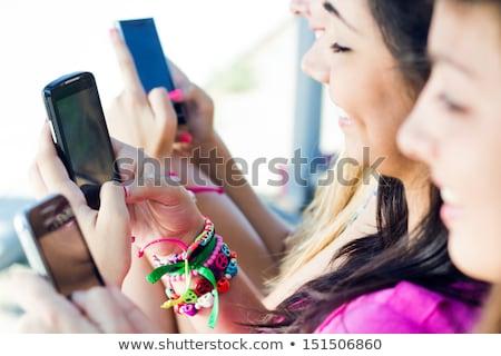 довольно · девушки · мобильных · этнических · полосатый - Сток-фото © deandrobot